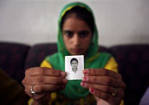Kaur displays the photograph of her brother Kuljit Singh, an Indian worker, who has been kidnapped in Iraq, in Amritsar