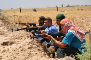 Iraqi Shi'ite Turkmen fighters take part in an intensive security deployment in the town of Taza