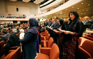 Members of the new Iraqi parliament take an oath at the parliament headquarters in Baghdad