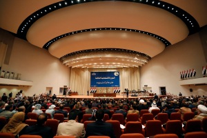 Members of the new Iraqi parliament attend a session at the parliament headquarters in Baghdad