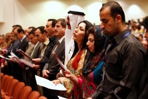 Members of new Iraqi parliament recite oath at parliament headquarters in Baghdad