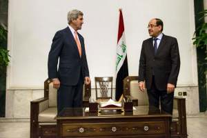 Iraqi PM al-Maliki and U.S. Secretary of State Kerry meet at the Prime Minister's Office in Baghdad