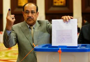 File photo of Nuri al-Maliki voting during parliamentary election in Baghdad