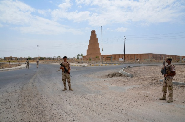 Iraqi soldiers stand guard near the Spiral Minaret during an intensive security deployment in Samarra