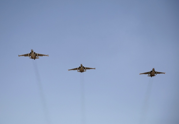 Russian Sukhoi Su-25 fighter planes arrive at Iraq's al-Muthanna military airbase at Baghdad airport, in Baghdad