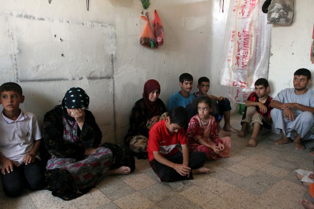 Shi'ite Turkmen families, who have fled the violence in Mosul, gather at a Shi'ite mosque in the town of Nahrawan, east of Baghdad