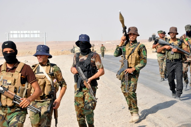 Iraqi security forces and Shi'ite militias advance towards town of Amerli from their position in the Ajana