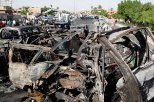 A view shows destroyed vehicles at the site of a triple explosion in a Shi'ite neighbourhood of New Baghdad