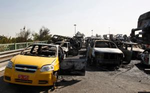 Wreckages of vehicles are seen after a triple bombing in a Shi'ite neighbourhood of New Baghdad