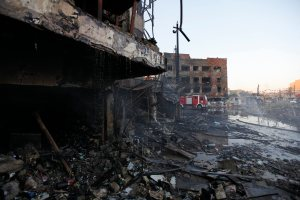 Destroyed building is seen at the site of a car bomb attack in Baghdad