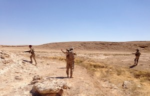 Members of Iraqi security forces take their positions during a patrol looking for militants of the Islamic State on the outskirt Haditha