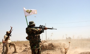 Mehdi Army clash with Islamic State militants outside the city of Tikrit