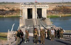 Mehdi Army, loyal to radical cleric Muqtada al-Sadr, patrol outside the city of Tikrit
