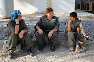 Female members of the PKK sit at their camp, near the frontline of the fight against Islamic State militants, in Makhmur