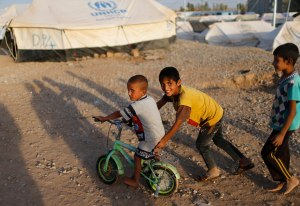 Displaced Iraqi children who fled from Islamic Sate violence in Mosul play outside their tent at Baherka refugee camp in Erbil