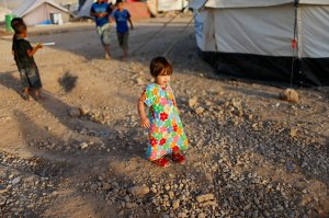 A displaced Iraqi child, who fled from Islamic State violence in Mosul, is pictured Baherka refugee camp in Erbil