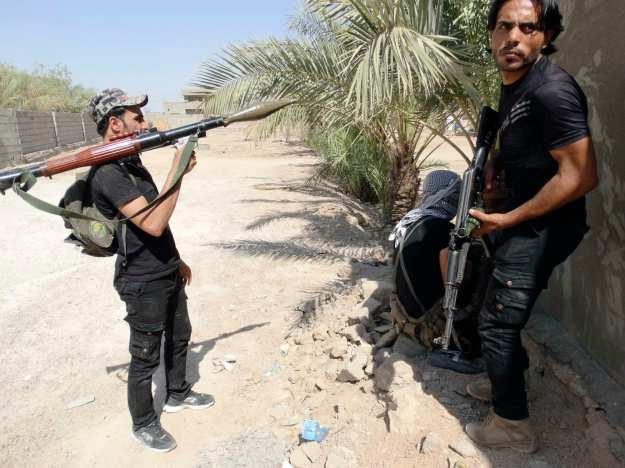 Members of Iraqi security forces and tribal fighters patrol looking for Islamic State militants on the outskirts of Ramadi