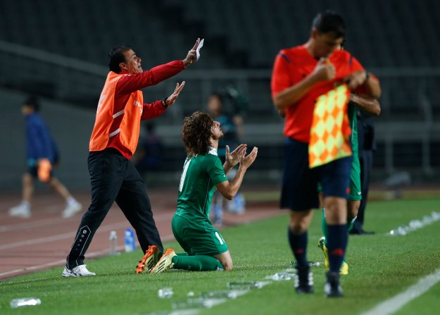 Iraq's Tareq Faraj celebrates after scoring a goal against Japan during their men's soccer qualifier match for the 17th Asian Games at Goyang Stadium in Goyang