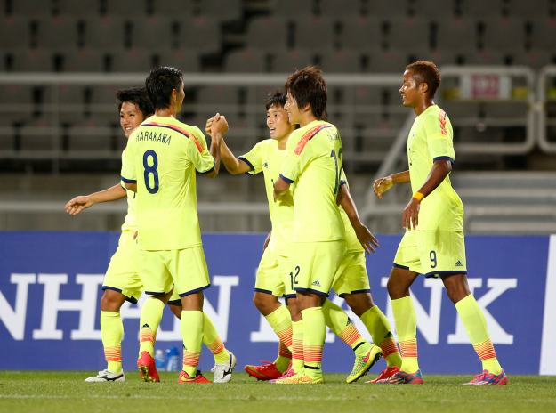 Japan's Nakajima Shoya celebrates with his teammates after scoring a goal against Iraq during their men's soccer qualifier match for the 17th Asian Games at Goyang Stadium in Goyang