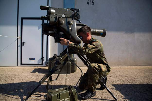 Soldier demonstrates a MILAN anti-tank rocket launcher that is part of a German military aid shipment for Kurdish forces in northern Iraq, at a storage facility of the Bundeswehr armed forces in Waren