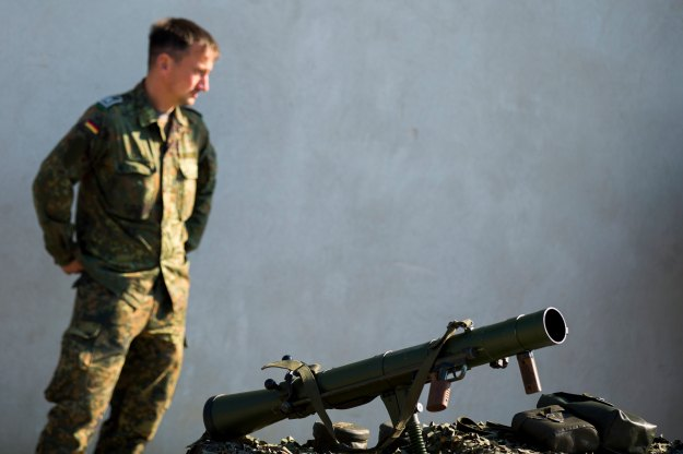 A soldier stands behind an anti-tank rocket launcher that is part of a German military aid shipment for Kurdish forces in Northern Iraq at a storage facility of the Bundeswehr armed forces in Waren