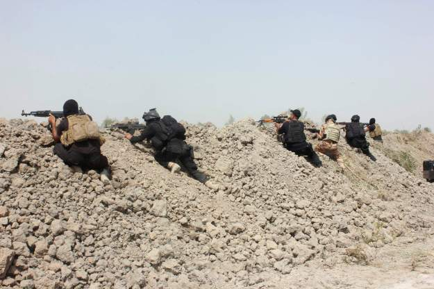 Iraqi SWAT troopers take position as they clash with Islamic State militants north of Muqdadiyah in Diyala province