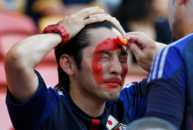 A Japan fan has his face painted before the Asian Cup Group D soccer match between Iraq and Japan at the Brisbane Stadium in Brisbane