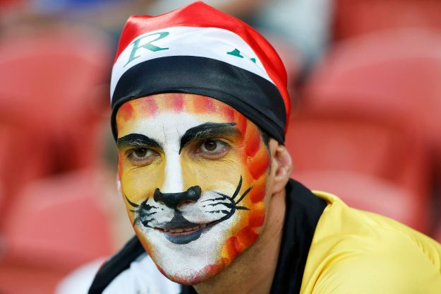 An Iraq supporter with his face painted awaits the start of the Asian Cup Group D soccer match between Iraq and Japan at the Brisbane Stadium in Brisbane
