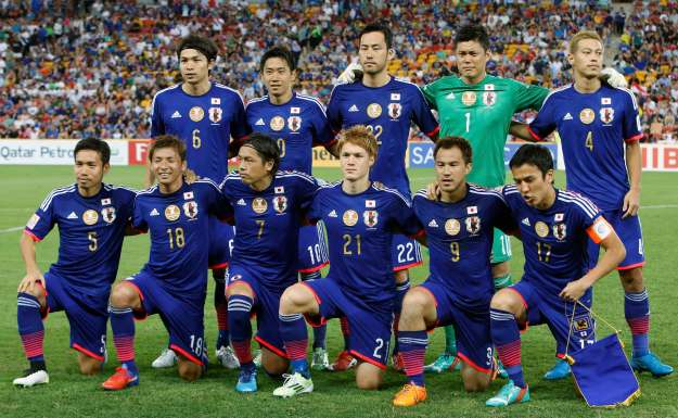 The Japan team poses for a photo before their Asian Cup Group D soccer match against Iraq at the Brisbane Stadium in Brisbane