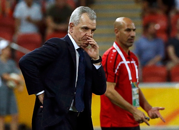 Japan's coach Javier Aguirre and Iraq's coach Radhi Shenaishil look on during their Asian Cup Group D soccer match at the Brisbane Stadium in Brisbane