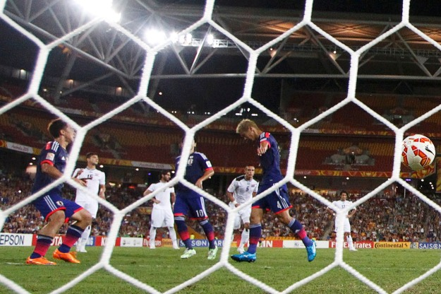 Japan's Keisuke Honda celebrates his goal from a penalty kick during their Asian Cup Group D soccer match agaist Iraq at the Brisbane Stadium in Brisbane
