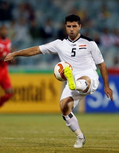Iraq's Yaser Safa Kasim controls the ball during their Asian Cup Group D soccer match against Palestine at the Canberra stadium in Canberra