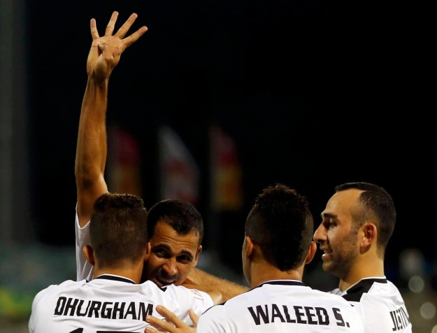 Iraq's Younus Mahmood celebrates with teammates after scoring a goal against Palestine during their Asian Cup Group D soccer match at the Canberra stadium in Canberra
