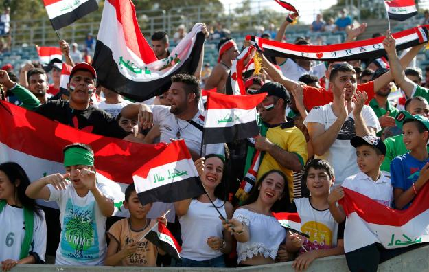 Iraq fans cheer before the Asian Cup quarter-final soccer match between Iran and Iraq at the Canberra stadium in Canberra