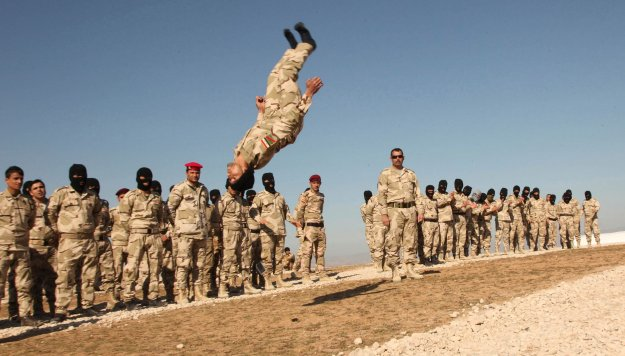 Volunteers from Mosul take part in military training as they prepare to fight against Islamic State militants, on the outskirts of Dohuk